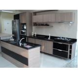 cozinha planejada com cooktop em guarulhos no Jardim Vila Galvão